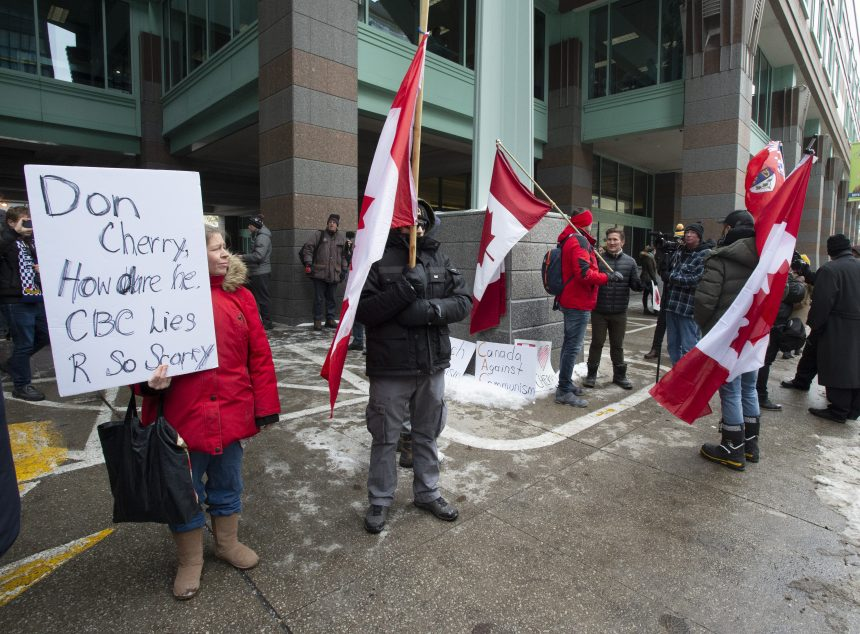 Small group of Cherry supporters protest his firing outside Rogers headquarters